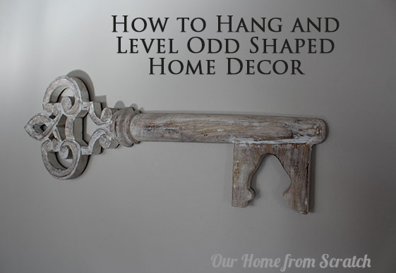 hang and level odd shaped decor
