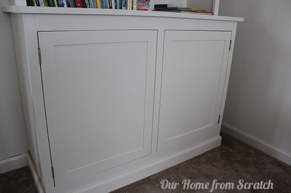 white cabinet without knobs