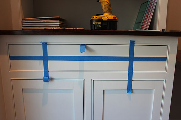 painters tape on cabinet